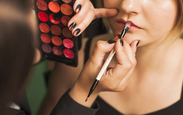 professional-woman-making-up-girl-s-lips_23-2148210744