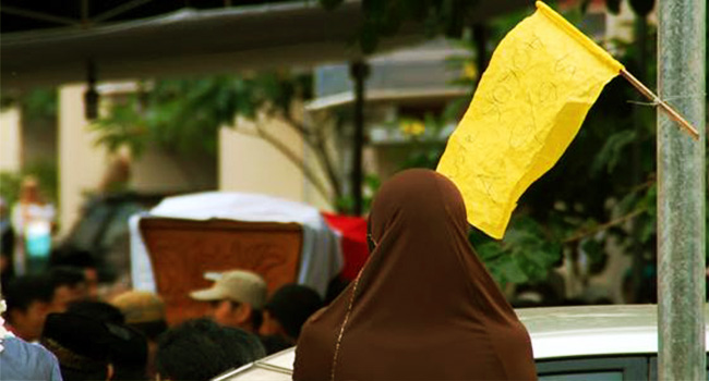 This image has an empty alt attribute; its file name is bendera-kuning.jpg